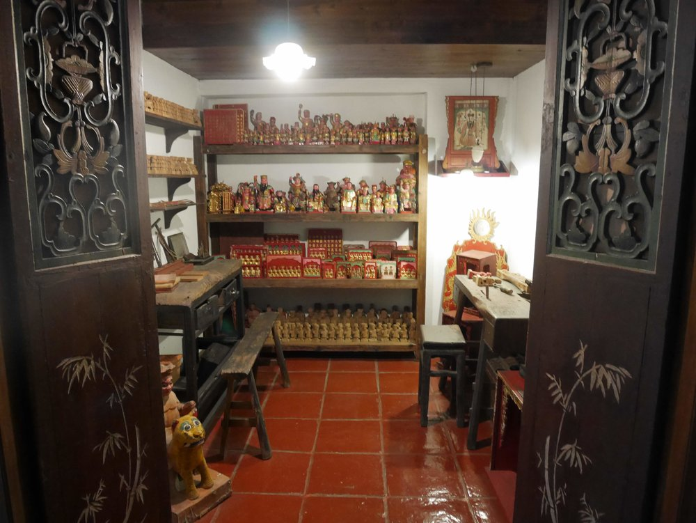 an exhibition display inside the Macau Museum about traditional shop houses