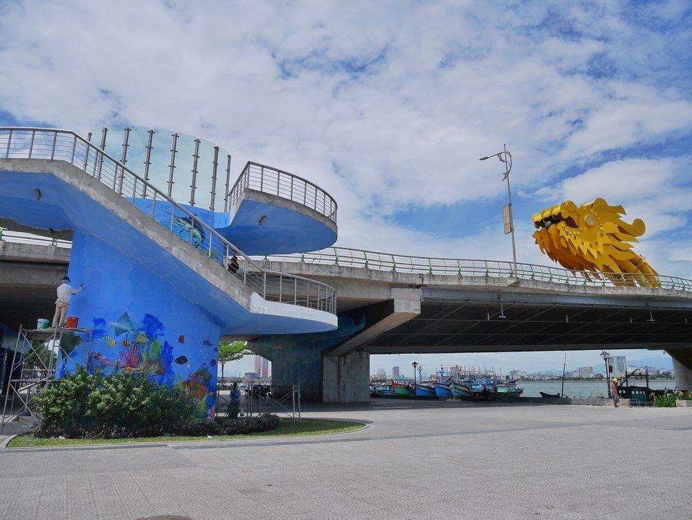 local artists painting undersea designs on the bridge over the Han River, Da Nang, Vietnam
