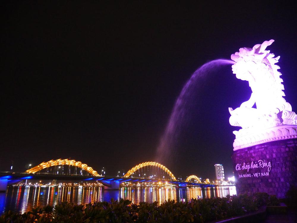 The Dragon Bridge and the Dragon Carp are lit up at night in Da Nang, Vietnam.