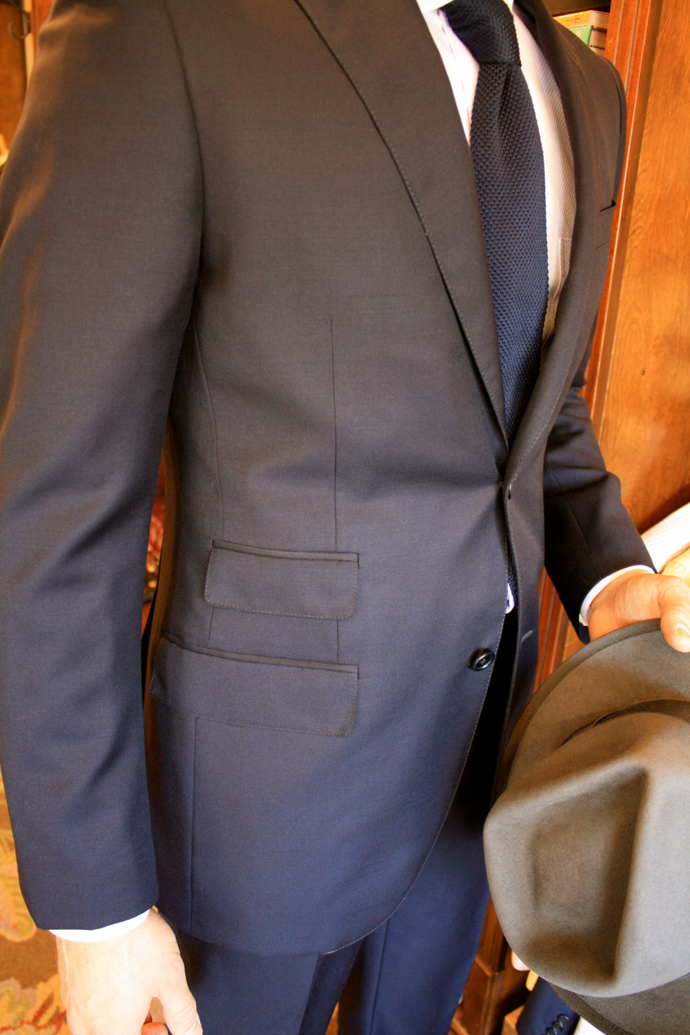 """The Work Horse"" This solid navy suit belongs in every mans wardrobe. We are presenting you with- ""The Work Horse"". Its a year round, super 130's, worsted wool and gaberdine that fits any need from special occasion to board room. A suit in this fabric would normally cost $1,450 but we are offering it for $750 till the end of February. As you know, fit is important to us, so any alteration you may need is complimentary. We are running of stock quickly, come have a look!"