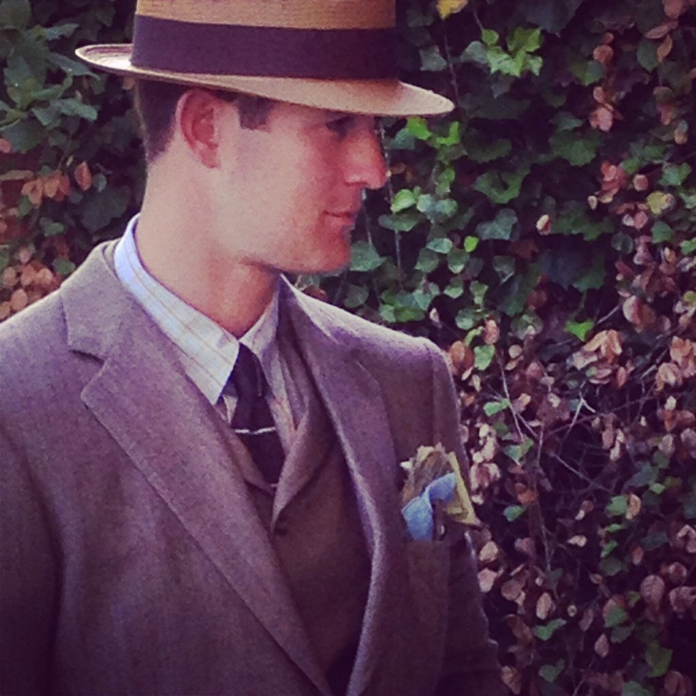 Logan Young sporting Loring & Co. shirt, tie, and coat.