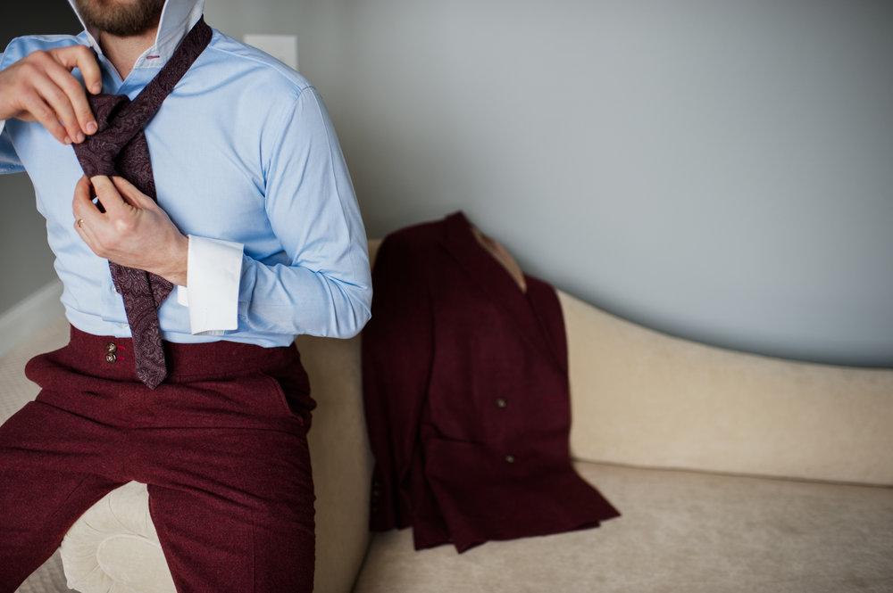 blue bespoke shirt Burgundy bespoke suit cuff link tying a tie