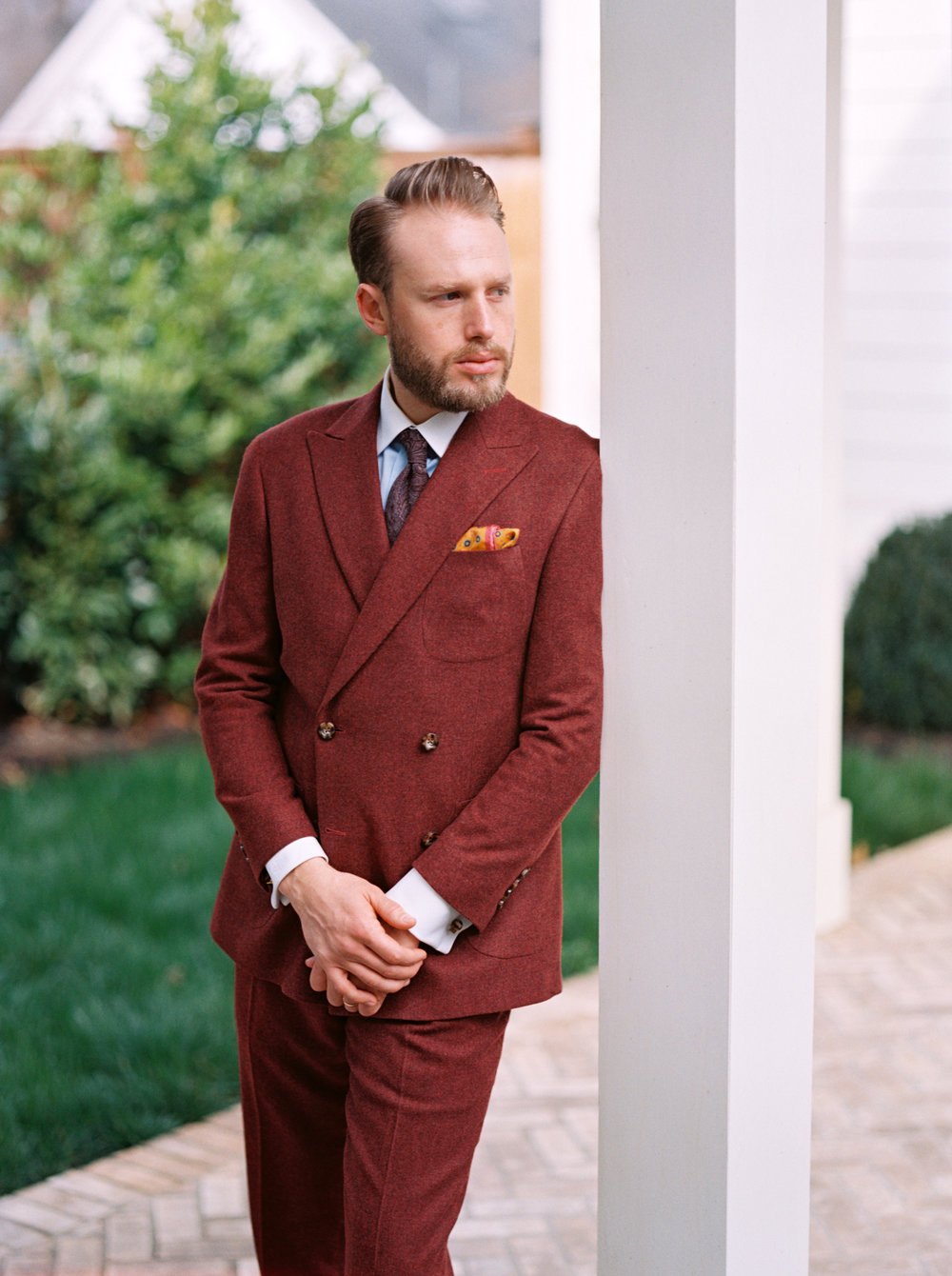 Bespoke suit in Burgundy at a white brick house in Nashville