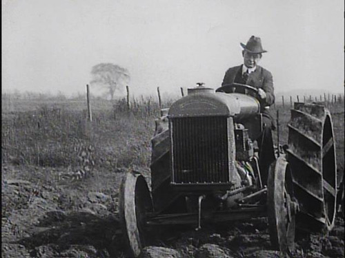 timeless fashion with man in suit driving tractor