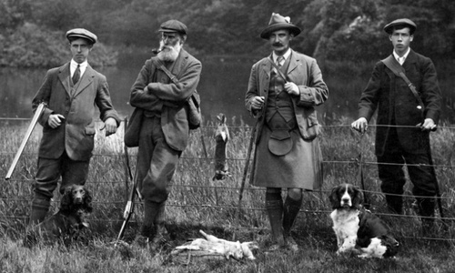 hunting men in bespoke suits