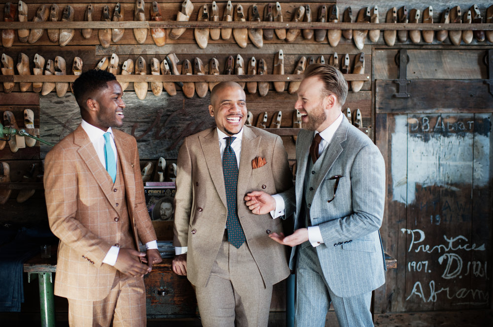 man in brown custom suit, tan custom suit, and gray custom suit talking at peter nappi