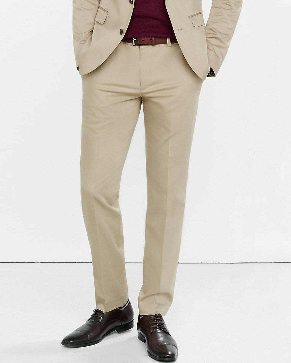 tan suit with black shoes
