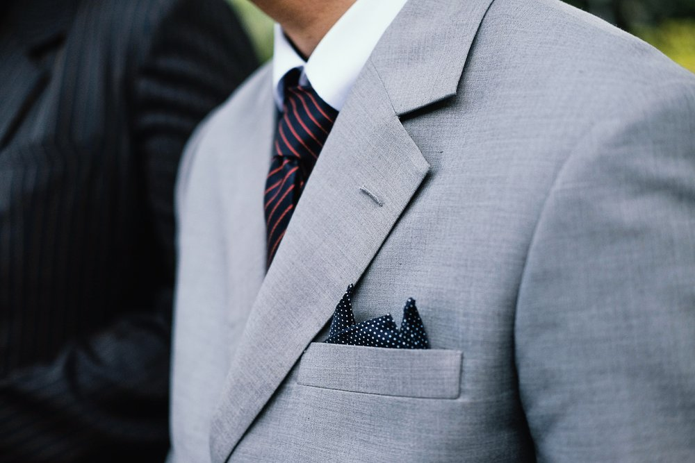 gray suit perfect for a man's cocktail attire