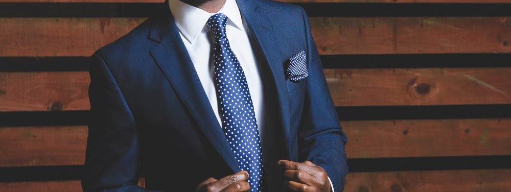 cocktail attire for men can be great in this navy suit
