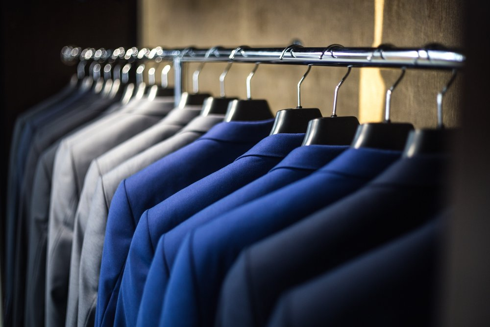 a variety of custom suits in different fabrics