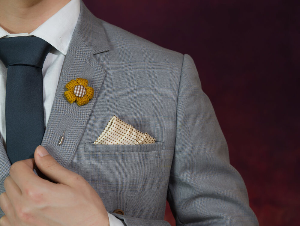 Gray suit with pocket square in one tip up fold