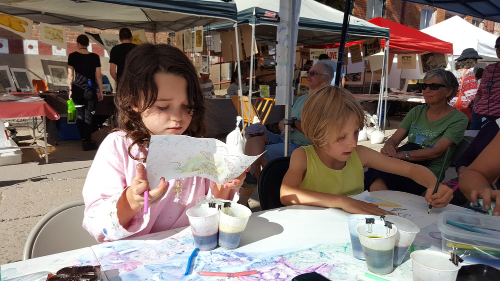 Exploring their creativity at Mimbres Region Arts Council's  Arte Para Todos  tent.