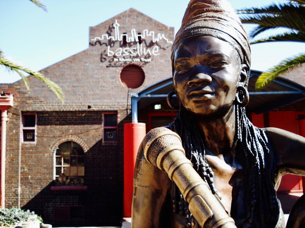 A public sculpture of the famed and tragic superstar so loved by South Africans: Brenda Fassie or Ma Brrr, in front of the old Baseline Music venue.