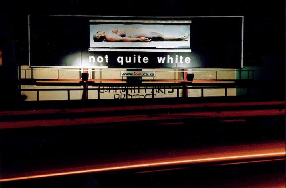 Bernie Searle:  Not Quite White.   Billboard on the Nelson Mandela Boulevard. for the BLAC public art project:  Returning the Gaze.   Photo by Nick Aldridge.