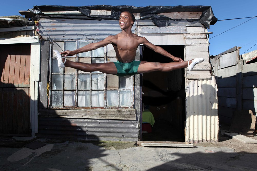 A ballet dancer in an informal community (township).  Photo by Bruce Sutherland.