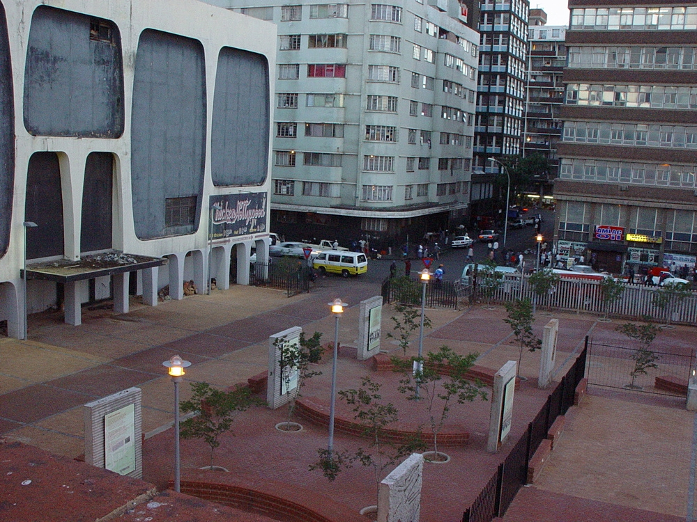 A view of a memorialised aspect of the old Drill Hall in the Joubert Park area in Johannesburg: the site of the  Treason Trail .  The memorial was built after most of the historic building burnt down - R10 million were spent on renovations in 2004.  For a number of years the site was occupied by arts groups who pushed boundaries, running projects and educational initiatives with limited funding in a complex and difficult urban environment.  The site is now largely derelict.  Photograph courtesy of Bie Venter