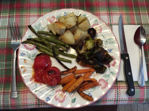 On weekends, we often have dinner in with our neighbors at  Ephraim Mountain Farm , when I get more than my fill of market-fresh veggies. This evening I enjoyed Esta's roasted potatoes, Brussels sprouts, carrots, tomatoes, and green beans. They're framed so nicely here on my favorite tablecloth of hers.