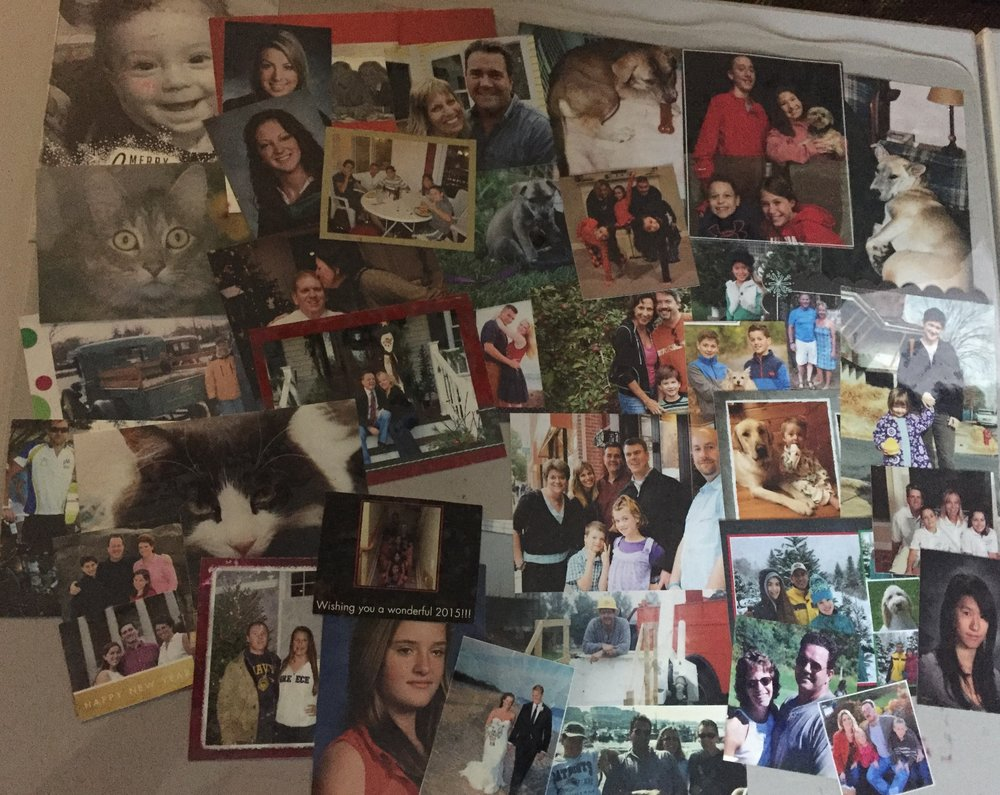 I've had this blotter for more than 17 years so it's stained with red ink, and some older pics are stuck to it--that's why you're featured twice, Liz ;) It protects shots of kids I haven't seen since they were toddlers, and friends (two- and four-legged) gone too soon. If it's under here, this photo came into my life at some point during that time, and if it didn't make it to a frame it went under the clear flexible plastic. I treasure each photograph, and all the memories they awaken.