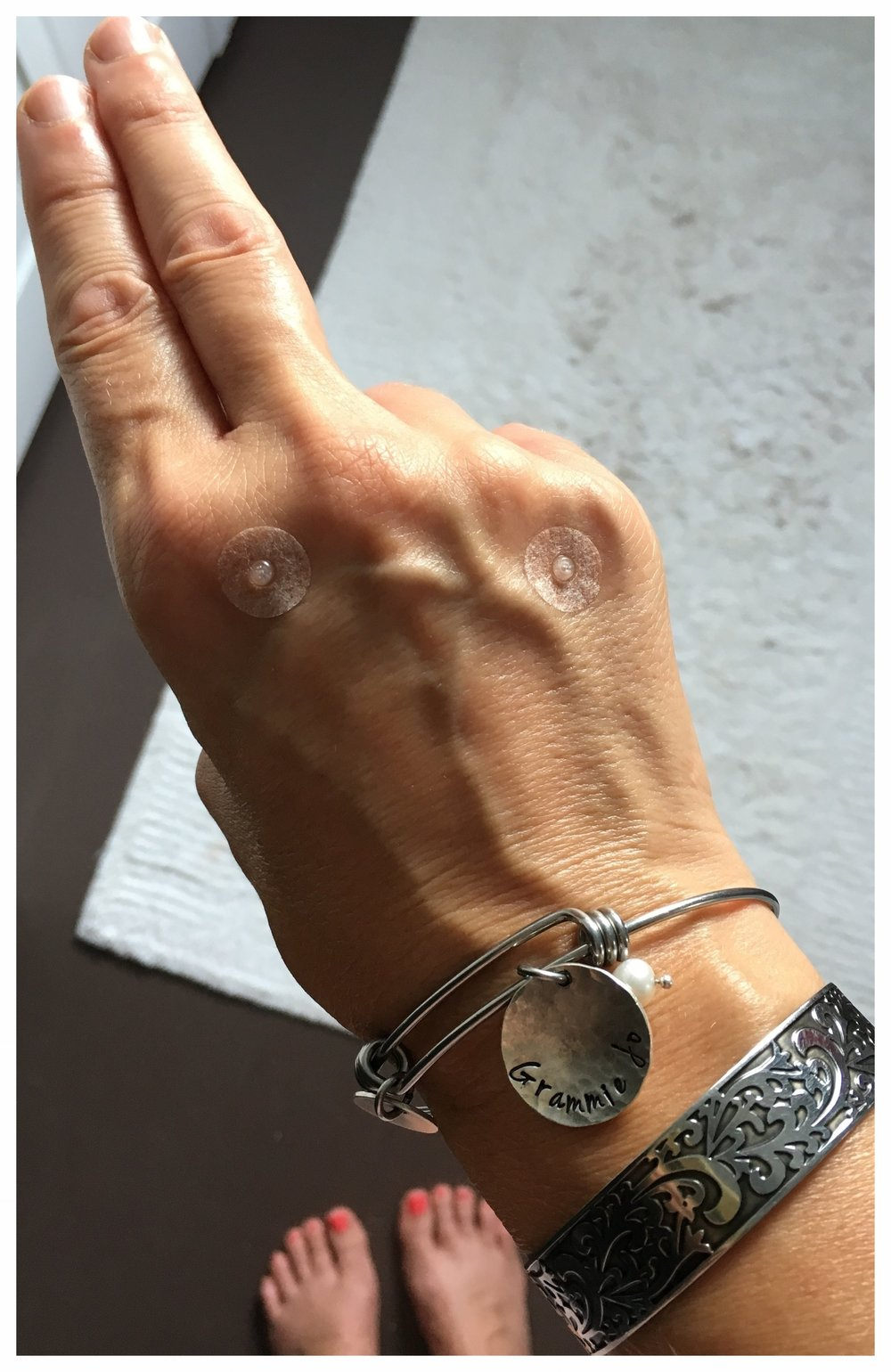 Press tacks on the back of my hand … featuring my favorite bracelet and the grounding energy of  bhu mudra , both in honor of my grandson Latham. Hey, Boo!
