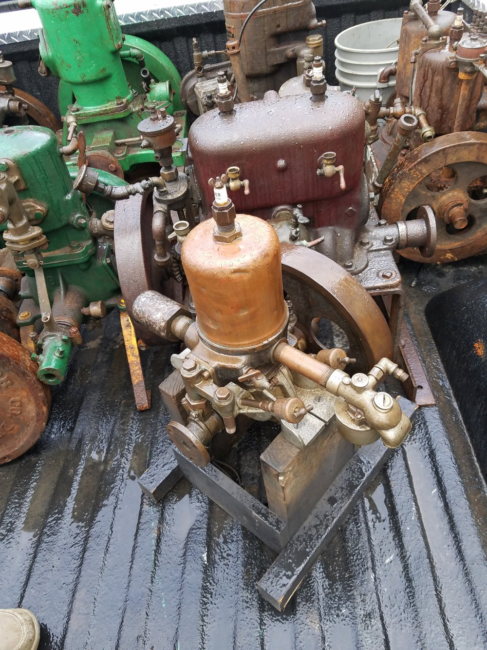 Drove to Michigan to score these little engines. Awesome old marine engines. These will be so much fun to restore! Snapped a few quick pictures, before we got them out of the rain. Perfect weather, until I rolled into the driveway. Murphy's Law!