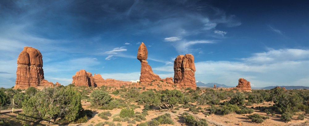 Balanced Rock Pano Arches National Park is quite a wonderland of rock. The impossible seems to be around every corner.  Balanced rock is probably the second most popular formation in the park; just behind Delicate Arch. We had beautiful blue skies while we were there.