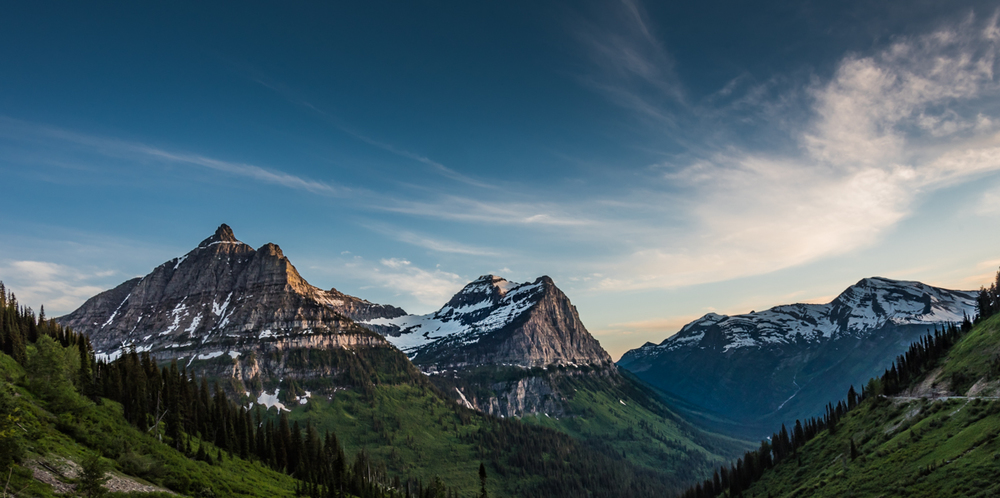 Panorama of Oberlin Clements and Cannon Mountains The Going to The Sun Road had only been open for a week when we showed up in Glacier National Park in late June. It was still pretty quiet on our way up to Logan Pass for this sunset.