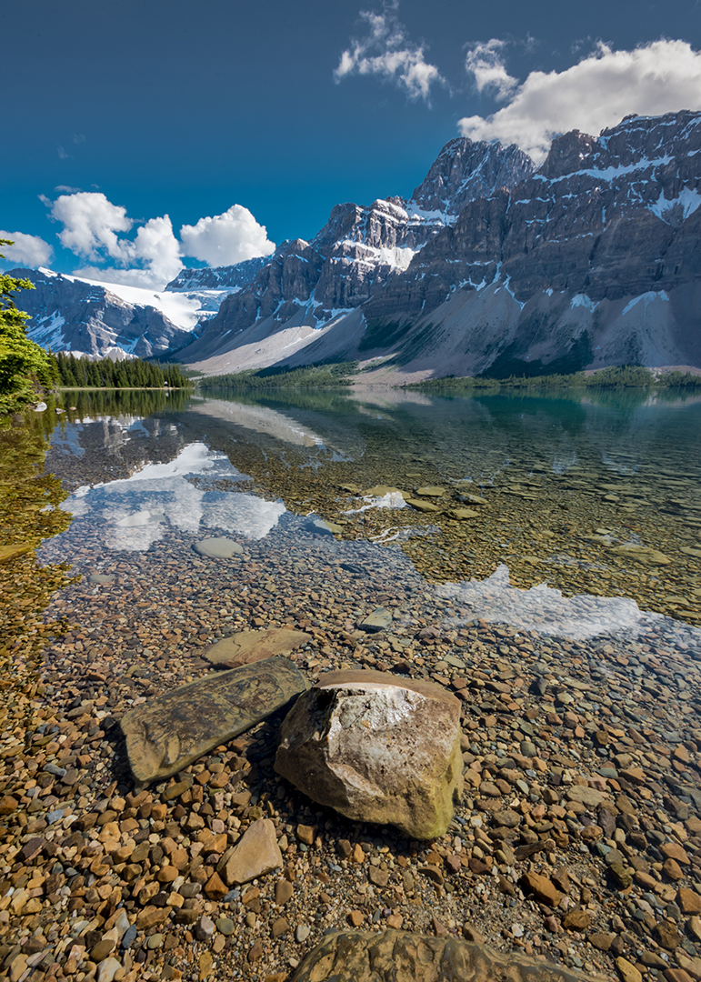 Large Rock Rises Above the Water At Bow Lake, Banff National Park