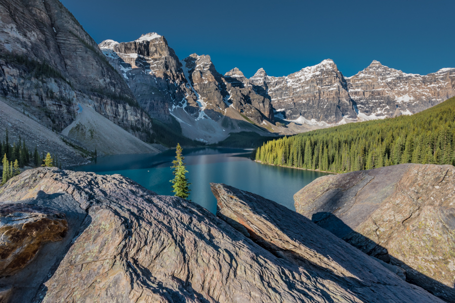 Blue waters of Moraine Lake underneath the Canadian Rockies