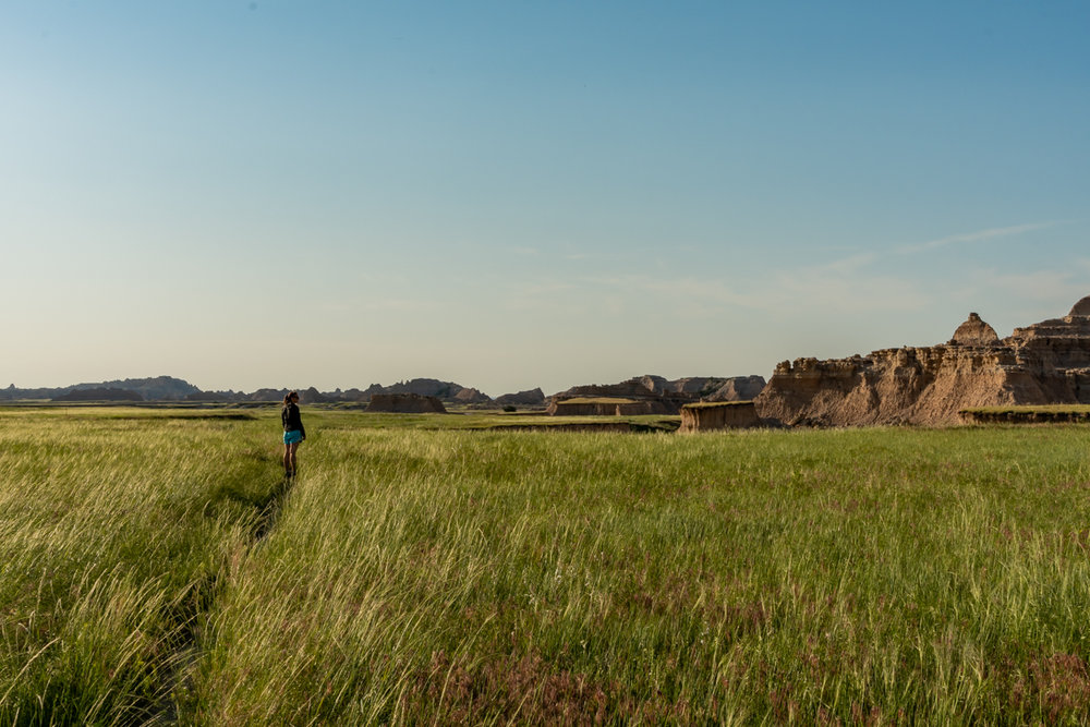 Woman Looks Out Over Badlands from Trail
