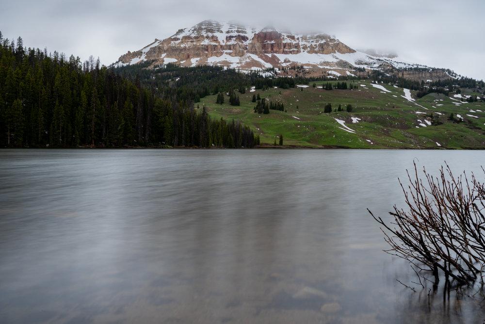 Snowy Mountain Peeks Out Across Beartooth Lake