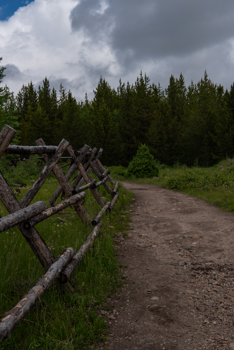 Wooden Fence Along Dirt Trail in Wyoming