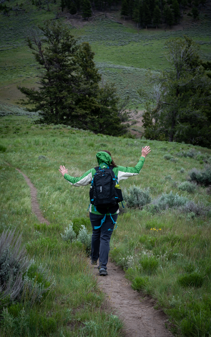 Woman Frolicks While Hiking in Yellowstone