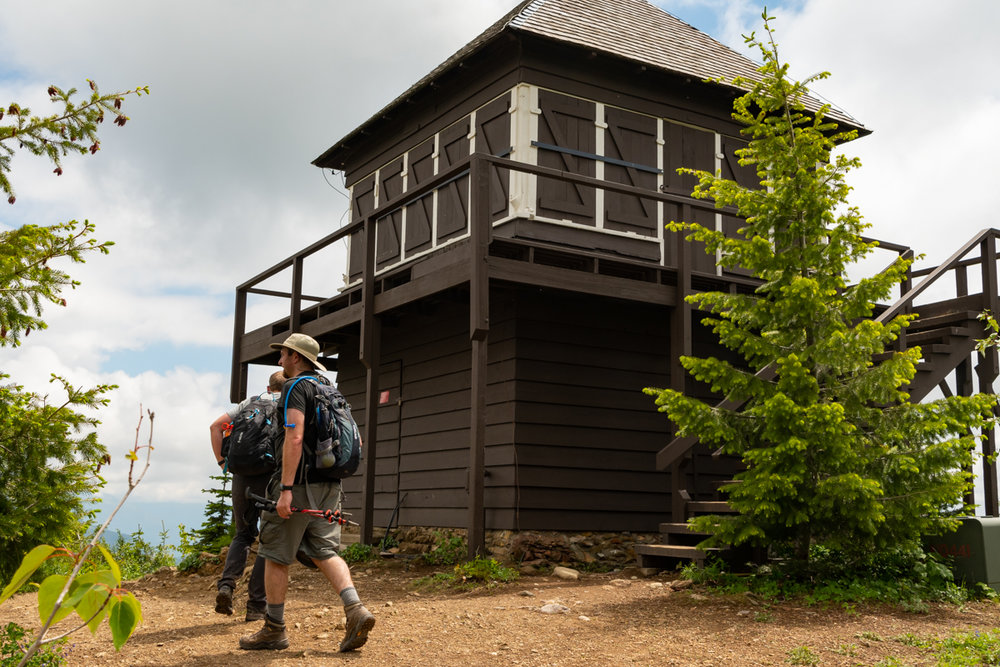 Two Men In Front of Apgar Lookout Tower