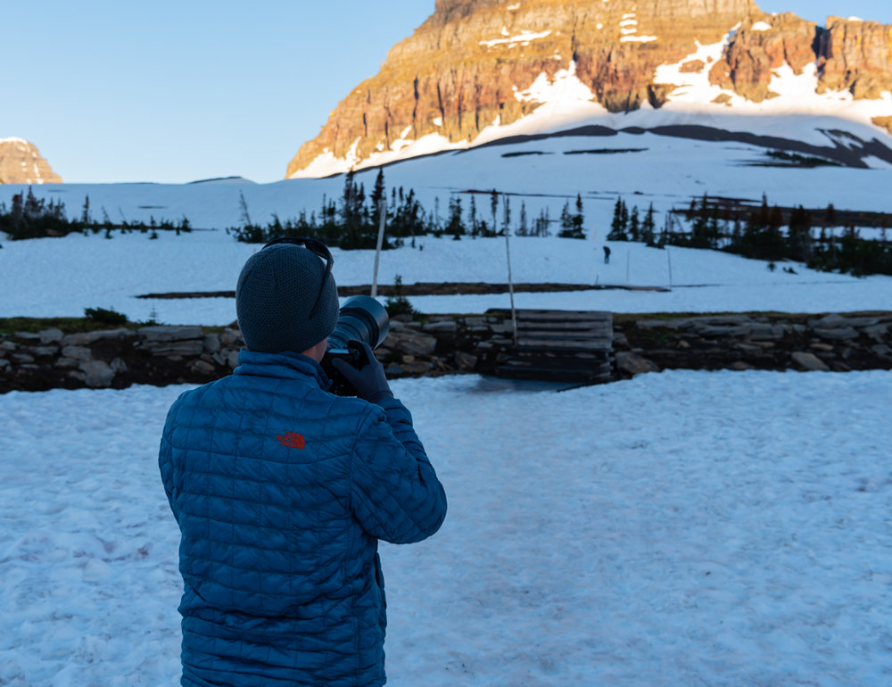 Man In Winter Clothes Takes Photograph