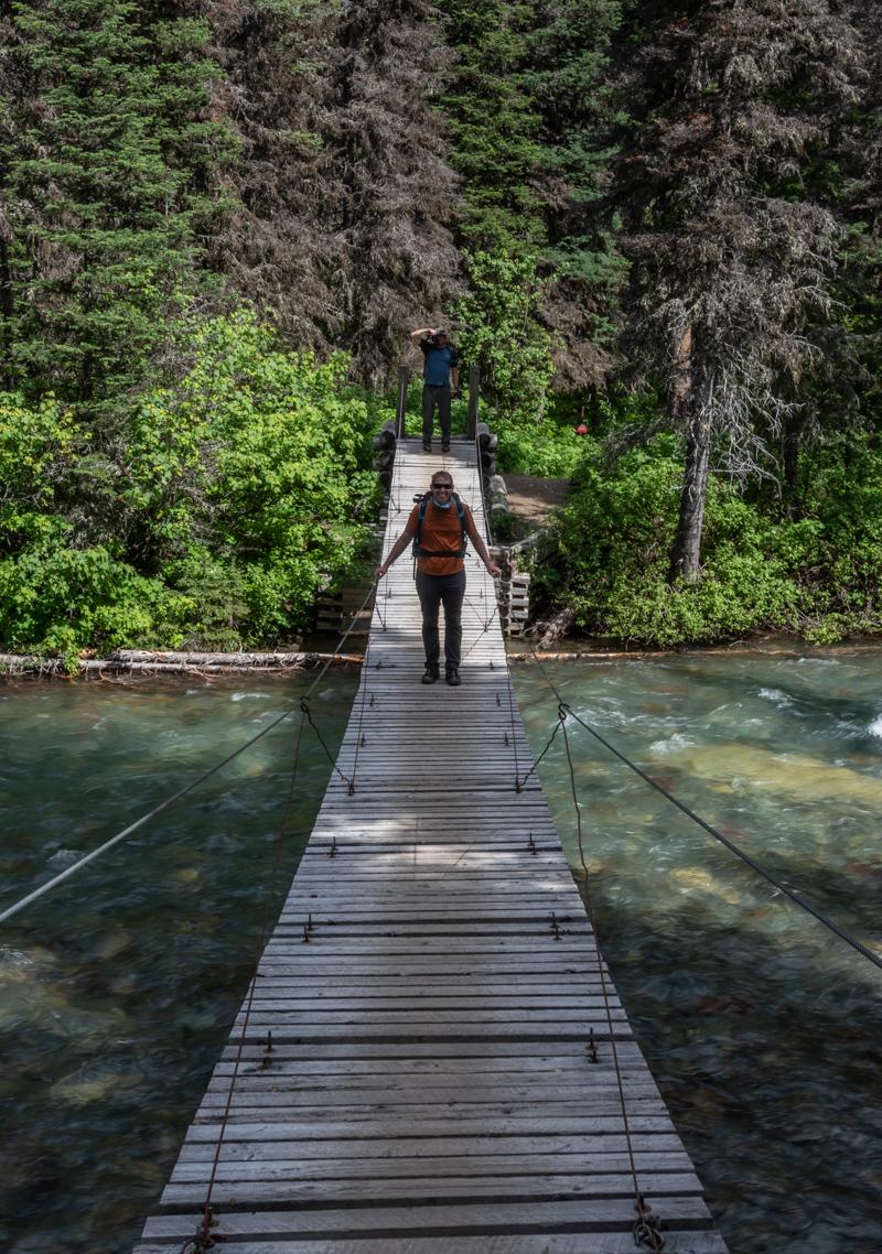 Man on Old Wooden Suspension Bridge