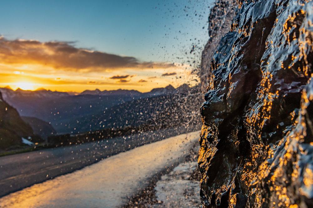 Sunlight Reflects off Waterfall Along Rock