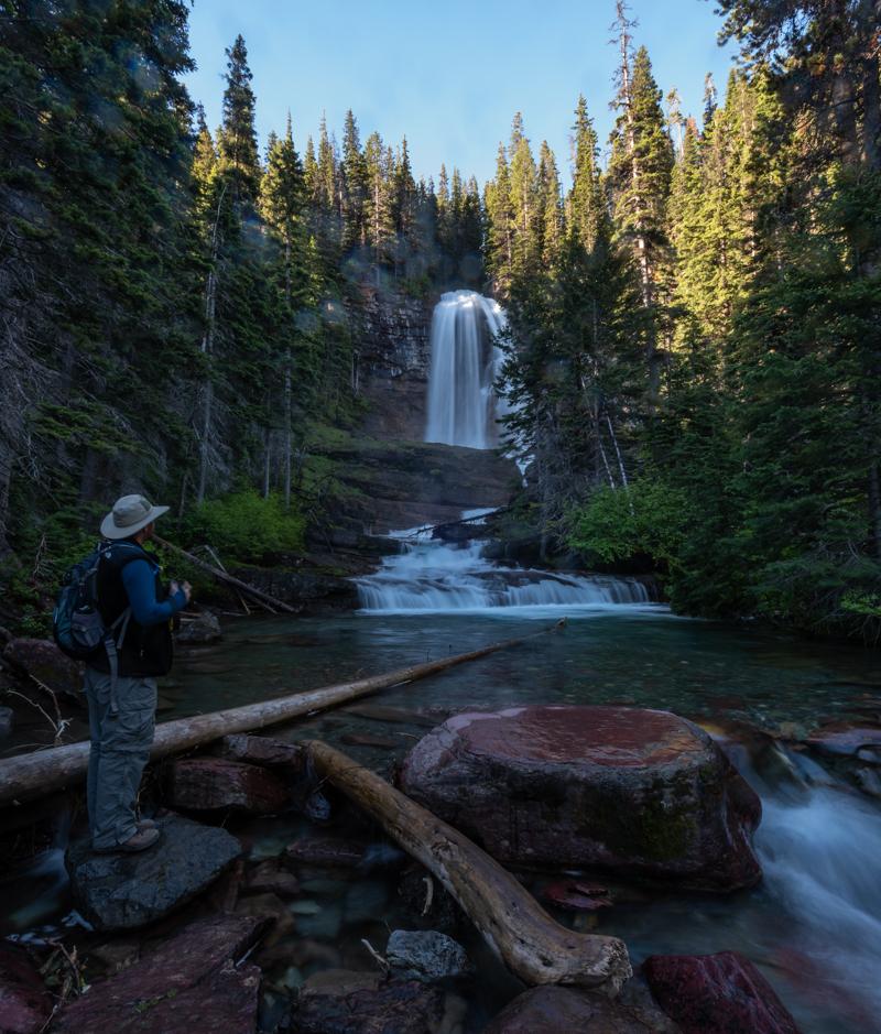 Man Stands Below Virginia Falls
