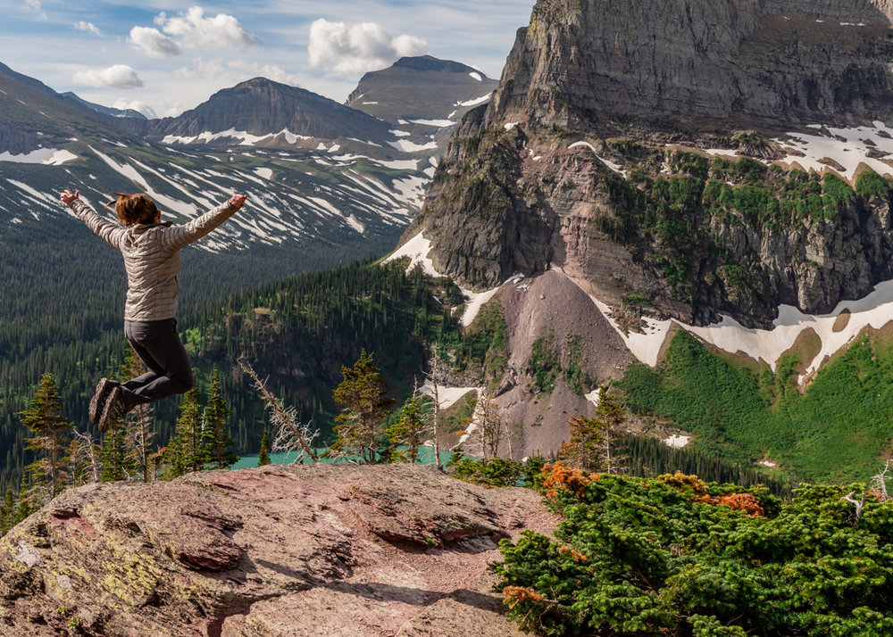 Woman Jumps for Joy At Sight of Mountains