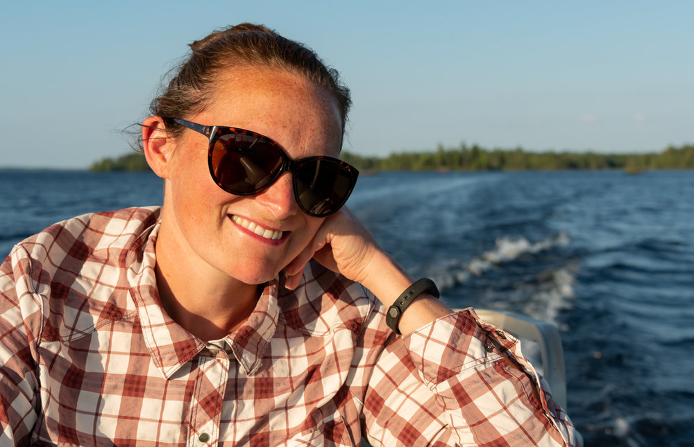 Woman in Sunglasses Smiles During Boat Ride