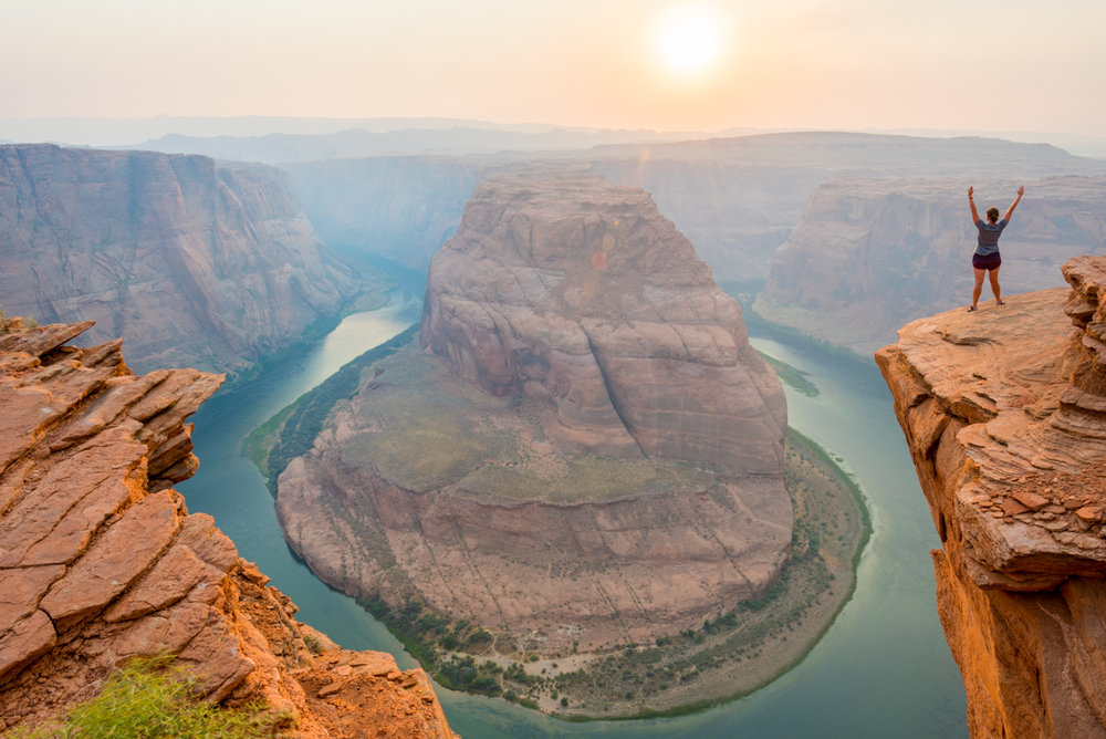 Woman Stands Over the Edge of Horseshoe Bend
