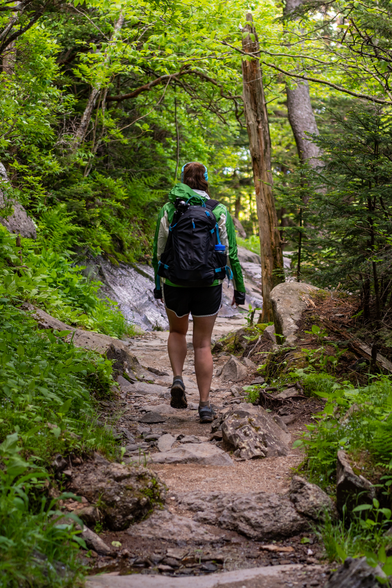 Woman hikes through forest in Smokies