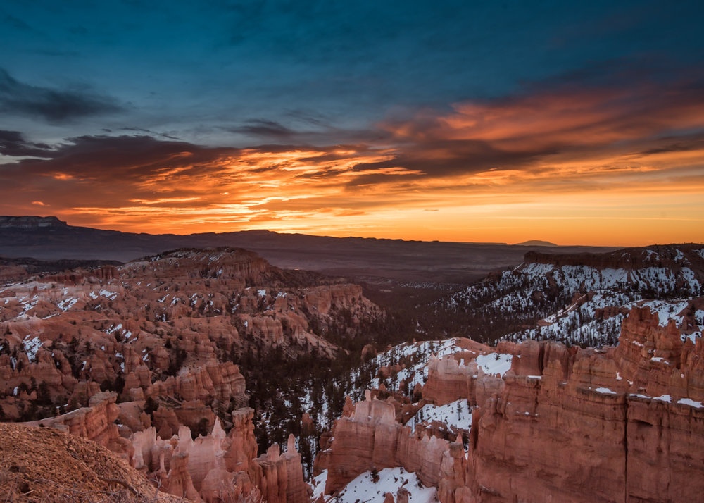 Snow Lingers on Bryce Canyon with Orange Sunrise