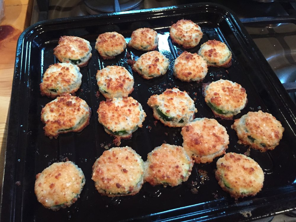 Just made these little zucchini parmesan crisps for happy hour.  I've got to get this recipe to you guys.... so good!!!!