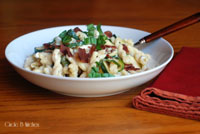 Pasta with zucchini, bacon and goat cheese