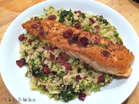 Oven-Roasted Salmon on Couscous with Shredded greens, cranberries and bacon