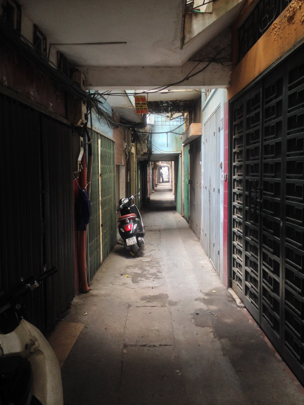 Hanoi, Vietnam   | This is the alley way I was wondering down, when a sweet woman invited me in for cold water. We are still friends today.