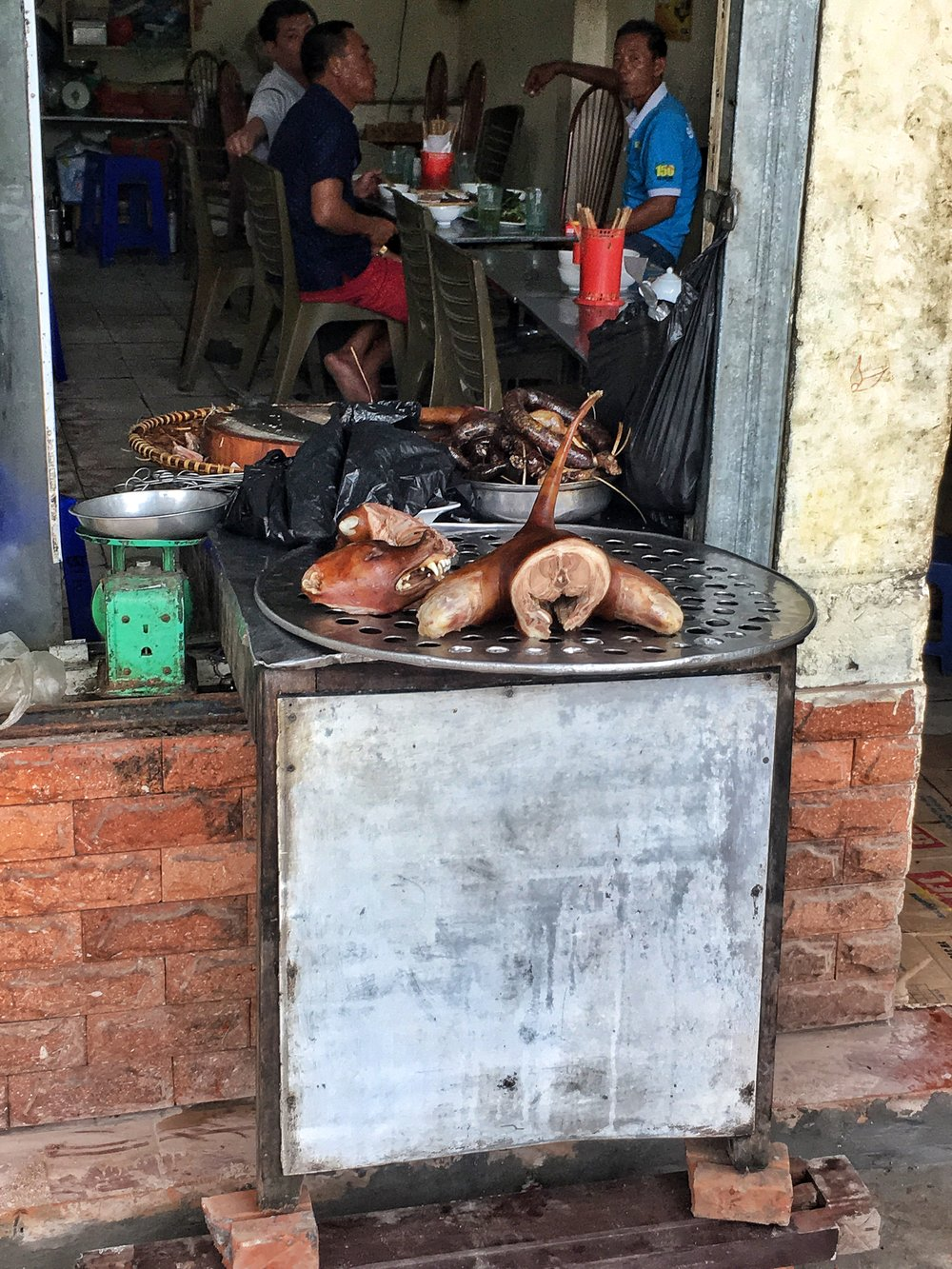 Hanoi, Vietnam | Roasted dog.   (photo courtesy of Jaclyn Houston - www.awholelottalovely.com)