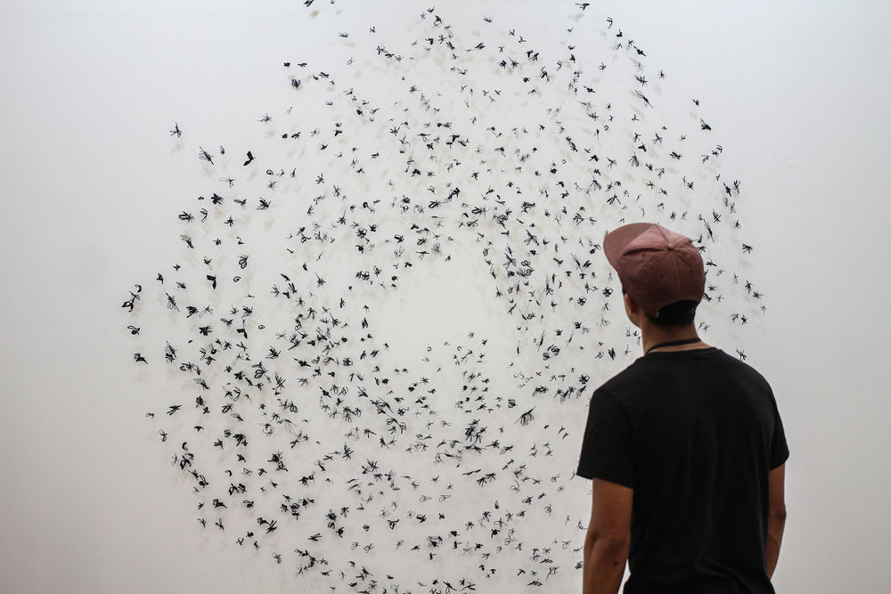 Frances Gallardo, Murmuration, 2017, 6 ft diameter, installation of laser cut paper pinned on wall. Photo: Stephanie Silva