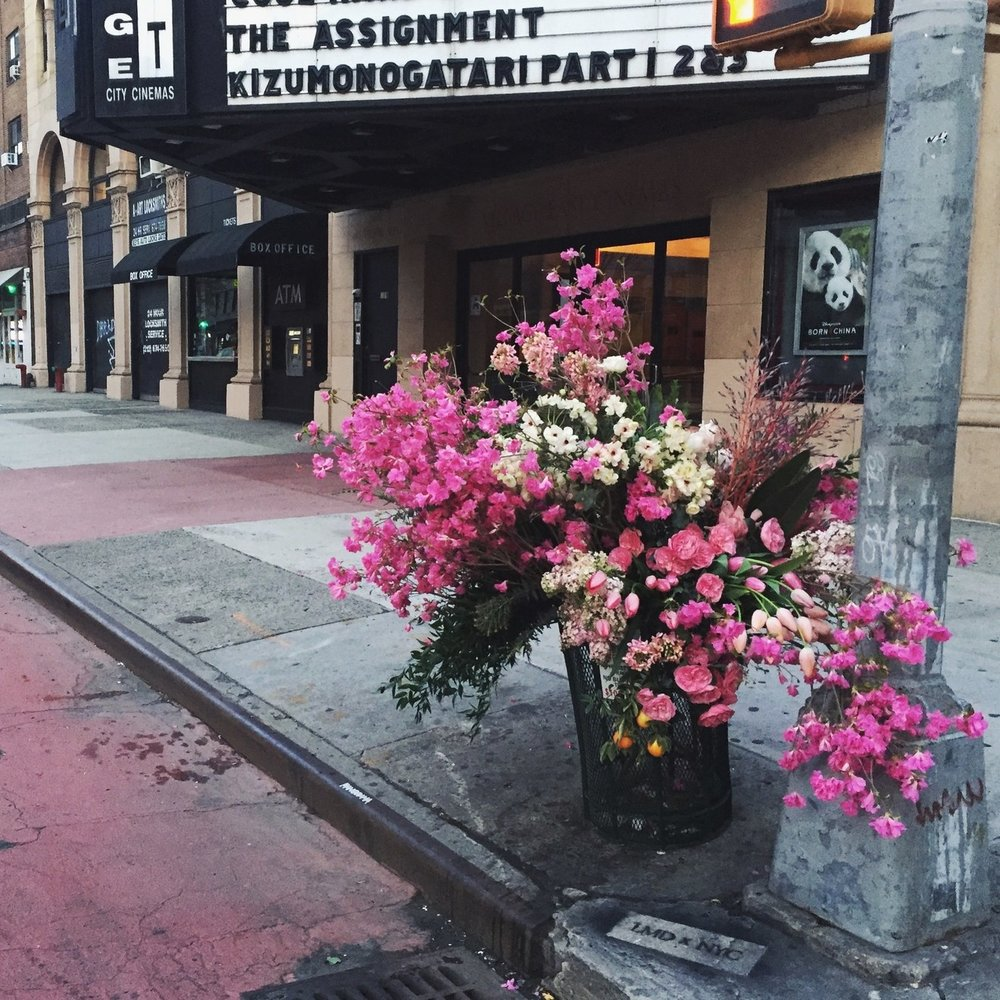 Lewis Miller has become NYC flower bandit. He flower bombs the city bring joy to any passerby that stops to smell the roses.jpg