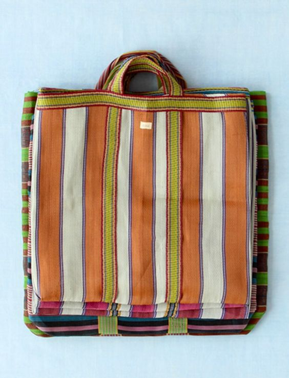 The Mexican - market bag. Colourful, beautiful, practical and can be folded into a quarter of its size to fit neatly into your tote/purse/suitcase if travelling to be used as an easy breezy beach bag.